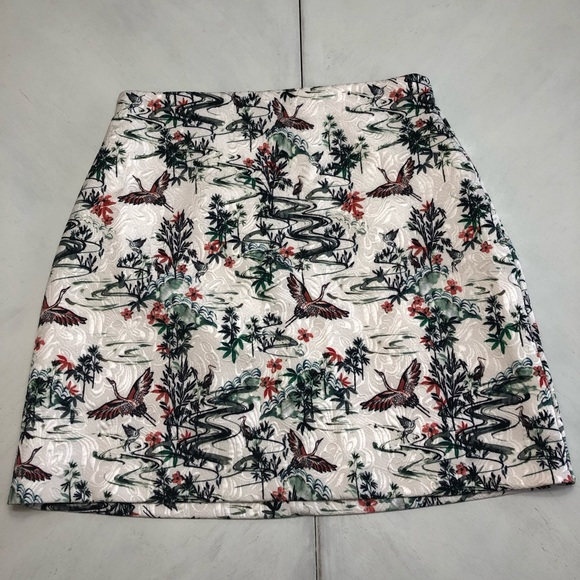 H&M Dresses & Skirts - Cream textured skirt with bird pattern